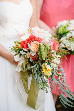 Bright coral and yellow blooms mixed with vibrant greenery to create the perfect summer wedding bouquet.
