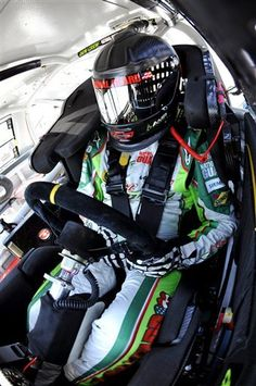 Dale Earnhardt Jr. sits in his car during practice for Saturday's NASCAR Sprint Cup Series auto race at Darlington Raceway, Friday, May 11, 2012