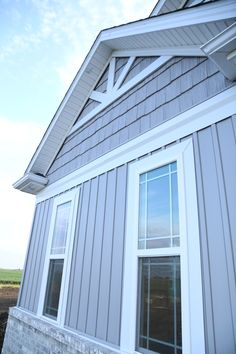 Love the board and batten vinyl siding! Not to mention the color is amazing.
