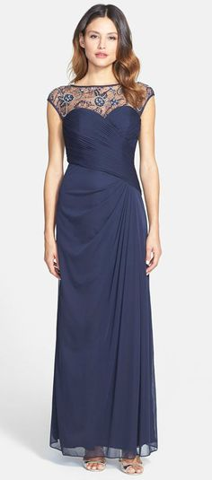 A gorgeous navy blue evening gown with illusion neckline details. Beautiful dress for the mother of the bride or mother of the groom