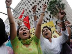 Chained Pakistani women shout for their rights at a rally to mark the International Women's Day in Karachi, Pakistan on Tuesday, March 8, 2005. Women Rights in Pakistan (AP/Shakil Adil)