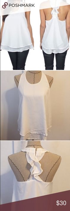 """🚨TAKE 50% OFF🚨 white ruffle tank top Ruffles on the back. True to size. Length approx 21"""". Pit to pit approx 16. 100 polyester. Tops Tank Tops"""