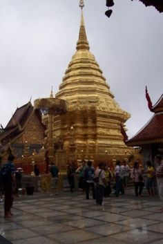 """Doi Suthep golden spire. Visit Chiang Mai, Thailand: """"[T]he...temple of Wat Phra That...is located near the top of Doi Suthep (Mount Suthep). The temple is... referred to as Doi Suthep by most people. [It is a] 15 klm trip up the winding mountain road to Doi Suthep. Built as a Buddhist monastery in 1383 it is still a working monastery today....The architecture, statues, murals and shrines seen here are nothing short of breathtaking."""""""