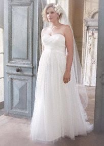 Magnificent is an understatement for this ruched tulle wedding dress. Long and soft, this delicate gown is simply gorgeous. Strapless bodice and elegant empire waist will cinch at the waist, then fall softly. Criss-cross ruching on bodice provides a slimming focal point. Sweep train. Sizes 16W-26W. White available for Special Order in stores. Missy: Style WG3438, Sizes 0-14. $399. Fully lined. Back zip. Imported polyester. Dry clean only. To preserve your wedding dreams, try our Wedding Gown…