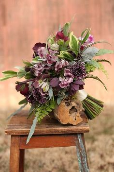 Woodland bridal bouquet with fern curls, purple scabiosa, sweet pea, fritillaria, succulents, dusty miller, variegated Solomon's seal and maidenhair fern.
