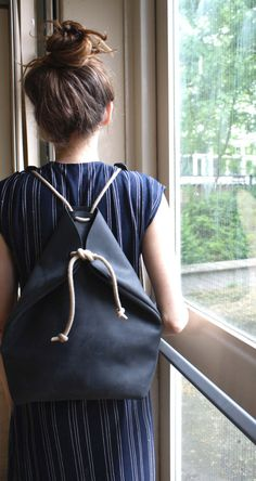 charcoal black and natural leather backpack