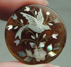 ANTIQUE MOP PEARL SHELL & SILVER INLAY IN HORN BUTTON ~ BIRD & FLORAL DESIGN
