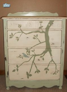 This is the free dresser I rehabbed and painted before Greta was born. It was a changing table at first, now it's our tv/media stand. Free handed the bird and branch and most of the leaves. Distressed it after painting and finished with antiquing glaze.
