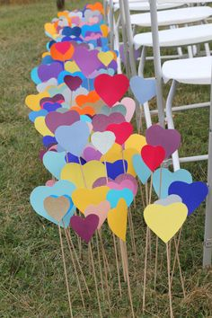 Love is in the air! Line your aisle, or even use as a ceremony backdrop, colorful hearts on sticks!