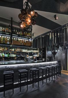 Love the black hardwood floors, the glow under the bar top, color of the bar top but different texture, like the liquor setup. Monopole — Sydney