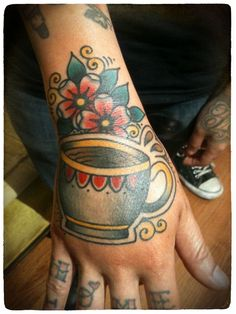 A cup of joe. Damn good coffee tattoo. Ashley Love. Also, a job stopper! Killer