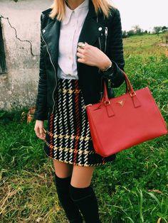 Plaid skirt and leather jacket with knee high socks and prada bag