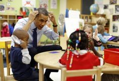 President Obama plays a game with children in a pre-kindergarten classroom at College Heights early childhood learning center in Decatur, Georgia,  February 14, 2013.  REUTERS-Jason Reed