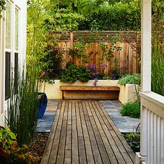 Less is more: A narrow side yard, transformed with decking and few, carefully selected plants.