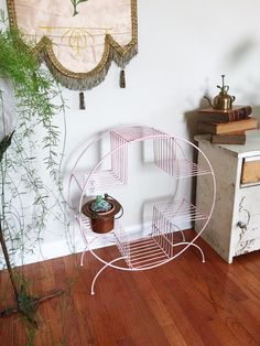 Vintage Pink Round Mid Century Modern Metal Wire Plant Stand or Book Shelf for Home Decor or Prop Display