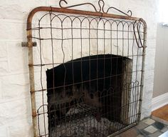Garden gate as fireplace screen. Could use on our outdoor fireplace too! - A Interior Design Farmhouse Fireplace Screens, Fireplace Gate, Fireplace Cover, Modern Fireplace, Fireplace Mantels, Fireplace Decorations, Mantles, Fireplace Ideas, Painted Fireplaces