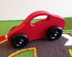Toy Car  Handcrafted Wooden Red Toy Car by McCoyToys on Etsy $9.00. Easy for little hands to hold.....smooth surface.  Click here: www.mccoytoys.etsy.com