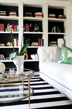 Take inexpensive bookcases from Target and turn them into built ins. Great hack and tutorial! black and white living room. Love the striped rug. White Living Room, Decor, House Design, Bookcase, Interior, Black And White Living Room, Living Room White, Target Home Decor, Home Decor Hacks
