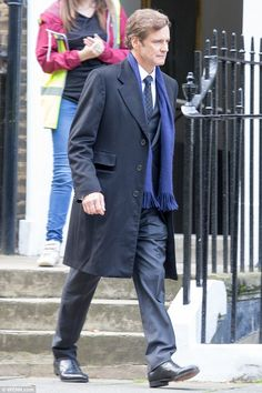 Looking sharp: Colin was back in character, looking suitably sharp in a black suit...