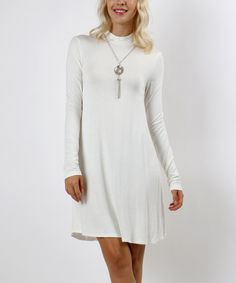 Take a look at this Ivory Mock Neck Shift Dress today!