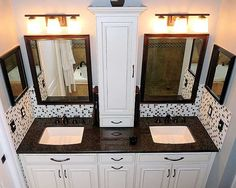 tower cabinet, framed mirrors- ?maybe to match cabinet wood, drop in sinks wtih granite counters but not this dark