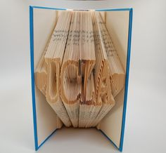 Book Art  UCLA  Upcycled paper  Folded book by eJewelryJunction