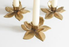 Vintage blossom brass candle holder / stick set.  Love this set of three flower brass candle sticks! They would look amazing on a teak credenza or on the festive dinner table. Or in the bed room for cozy hours ;)  Condition: very good vintage / no scratches or repair  Measurements: 11,5 cm / 4.5  -----------------------------------  SHIPPING:  • Orders are shipped ensured via registered priority mail. • Overpayed shipping fees will be refunded • Express delivery can be arranged...