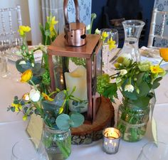 Beautiful spring flowers, lanterns and tea lights for a spring wedding from the Wilde Bunch