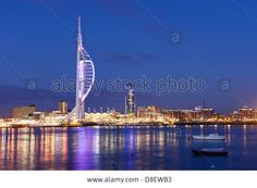 Spinnaker Tower And The Skyline Of Portsmouth Harbour Stock Photo, Picture And Royalty Free Image. Portsmouth Harbour, Cn Tower, Night Time, Royalty Free Images, Skyline, Stock Photos, Lights, Website, Building