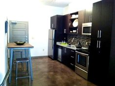 """View of Kitchen & Entry way from """"Living Room"""" (My unit will be about 1 1/2 feet narrower than this)"""