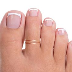 This dainty toe ring has a tiny band and knot. Also available in gold filled or rose gold filled.Thank you for viewing! We look forward to serving you! French Tip Toes, French Toe Nails, French Tip Pedicure, French Manicure Toes, French Pedicure Designs, Pretty Toe Nails, Cute Toe Nails, Pretty Toes, Gel Nails