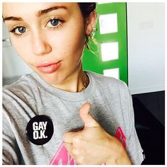 "Miley Cyrus shared her support for the Supreme Court's gay marriage ruling with a selfie on Instagram, flashing a thumbs up while wearing her ""Gay OK"" pin."