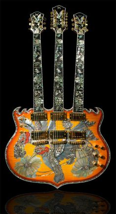 Minarik Trinity Tripleneck Guitar. How in the world would you even play this