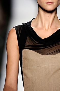 Narciso Rodriguez.  Yow!  Look at that draped black chiffon neckline with the camel-toned woven bodice!