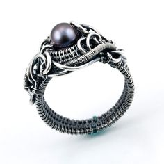 Freshwater Peacock Pearl and Fine Silver - This is so badass! I love it!