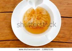 Cup of tea with pouring milk