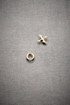 i love wearing these earrings. very rarely do ppl notice it's an x AND an o. it's almost like your own little secret.