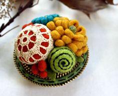A much smaller pincushion....