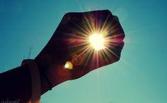 Sun in hand