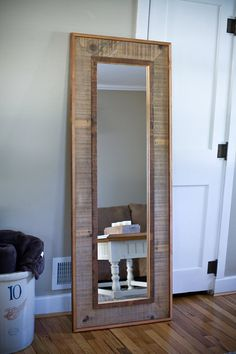 This beveled mirror was framed using reclaimed wood taken off of an old corn crib in Northern Iowa. The inner and outer borders of the frame have a clear finish on them to bring out the color in the wood. The dimensions of the mirror are 12.5 wide by 53 Long. With the frame it measures roughly 24 1/4 by 64 3/4 Long. Please note that this mirror does not come with any hanging hardware. It can be hung either way depending on your space or just standing as a full length mirror. Any que...