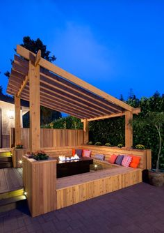 A little too modern looking but 3-sided wood bench. could do this with pergola in the other direction off the house