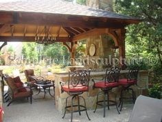 A pavilion is a great place for an outdoor bar and fireplace.