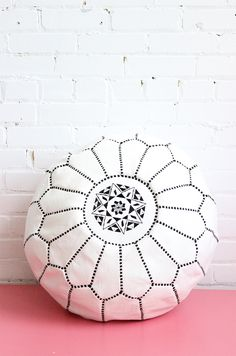 White Morrocan leather pouf with black embroidery, from  Baba Souk