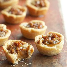 Pumpkin-Pecan Tassies - These tiny pies, baked in a muffin tin, showcase the flavors of pumpkin and pecans in a one- or two-bite dessert.