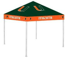 "Miami Hurricanes NCCA Ultimate Tailgate Canopy (9x9) by Rivalry Distributing. $189.99. Size: 9' x 9'. Logos On All Four Sides. Easy Set Up. Multiple Height Adjustments. Water Resistant. Stay cool and dry under the Ultimate Tailgate Canopy. Durable and water resistant 9' x 9' canopy. 12"" wide valance with larger logos, 6' clearance from valance to ground. Heavy duty steel frame and 180g/m2 fabric. Easy to set up and take down! Three - Height adjustable.. Save 24%!"