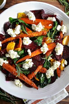 Roasted Beets and Carrots Salad with Burrata Roasted beets and carrots with sautéed beet greens tossed with honey rosemary vinaigrette and topped with burrata. A perfect fall vegetable side dish. - Roasted Beets & Carrots Salad with Burrata from Fall Vegetable Side Dishes, Vegetable Sides, Veggie Dishes, Veggie Recipes, Vegetarian Recipes, Cooking Recipes, Healthy Recipes, Beet Salad Recipes, Health Salad Recipes