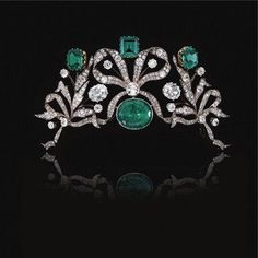 Emerald and diamond tiara, circa 1870 - Photo Sotheby's: Designed as series of bows entwined with foliate sprays set with cushion-shaped and circular-cut diamonds, centring on an oval emerald surmounted by an octagonal emerald, a step-cut emerald and a hexagonal emerald.