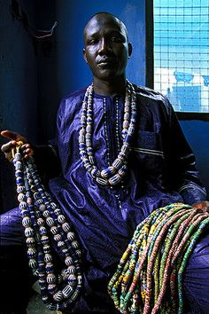 Africa | A merchant from Odumase with some necklaces made with glass 'chevron' beads of Venetian origin. Ghana  | © Bruno Zanzottera.