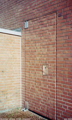 brick door by Dystopos via Flickr & Picture of the Day: Super Sneaky Sliding Brick Wall Door | Strange ...