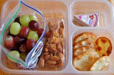 Grapes, almonds, pita crackers, cheese.